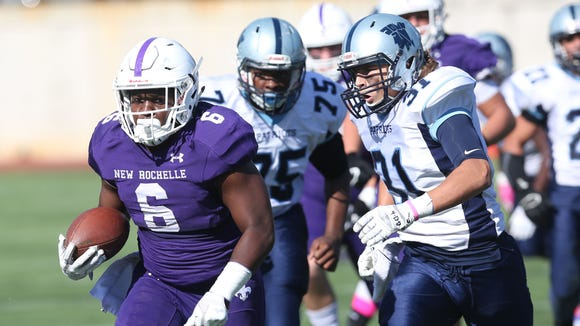 New Rochelle's Jared Baron (6) looks for some running
