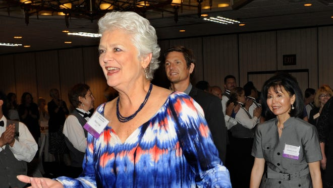 Mary Lau, left, is shown entering the room with other honorees during the Nevada Women's Fund's 2014 Salute to Women of Achievement in May. Lau is considered one of the leading lobbyists of the Nevada Legislature. She is the president and CEO of the Retail Association of Nevada.