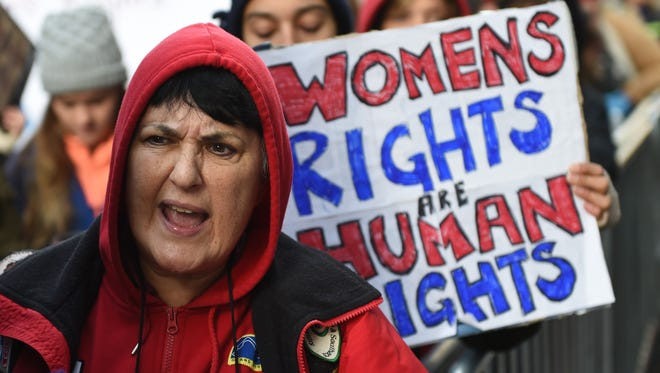 Women rally as part of a nationwide protest against U.S. President-elect Donald Trump outside of Trump Tower on December 12.