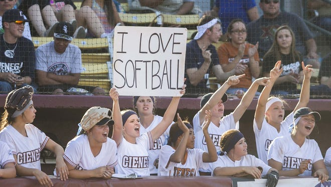 Cienega players yell from the dugout during the 2015 Div. II softball Championship at Farrington Softball Stadium in Tempe.