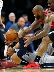 Pistons forward Tobias Harris (34) competes with Raptors