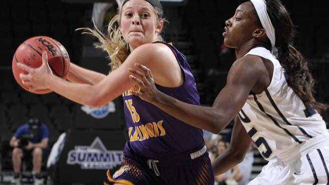 Western Illinois' Emily Clemens (left) looks to pass past Oral Roberts' Faith Ihim at the 2016 Summit League Tournament.