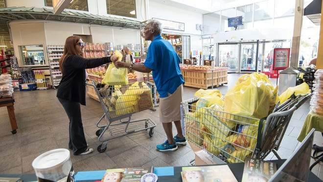 9/16/17- Neptune NJ.  APP employee Pauline Mancle ( right)  gathers donations in the Move For Hunger food drive at Shop Rite in Neptune.