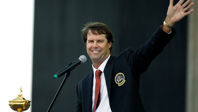 FILE - In this Sept. 18, 2008, file photo, United States team captain Paul Azinger waves to spectators while speaking at the Ryder Cup opening ceremonies at the Valhalla Golf Club, in Louisville, Ky. NBC Sports is hiring Azinger as its lead golf analyst with hopes he can deliver his own brand of sharp, candid observations that made Johnny Miller such a strong presence in the broadcast booth for three decades. (AP Photo/Chris O'Meara, File)