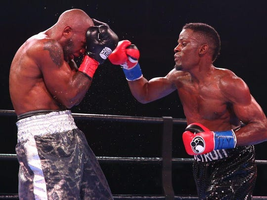 Detroit fighter Tony Harrison, right, defeats Cecil McCalla by unanimous decision on Oct. 31, 2015.