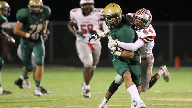 City High's Zach Jones tackles West High's Oliver Martin during their game at West High on Friday, Sept. 16, 2016.