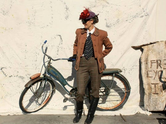 A rider is all dressed up with her vintage bicycle for the Missoula Tweed Ride.
