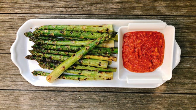 Grilled asparagus gets a tasty boost with Romesco sauce.