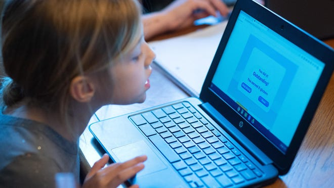 File - Audrey Priore, 7, completes school work at her home in Northampton in March. The Council Rock School District is among those starting its school year with full-time virtual learning for all students.