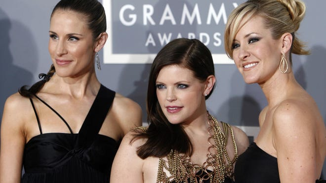 FILE - In this Feb. 11, 2007 file photo, the Dixie Chicks, Emily Robison, left, Natalie Maines, center, and Martie Maguire arrive for the 49th Annual Grammy Awards in Los Angeles. The Grammy-winning country group have dropped the word dixie from their name and are now going by The Chicks. The move follows a decision by country group Lady Antebellum to change to Lady A after acknowledging the word's association to slavery.