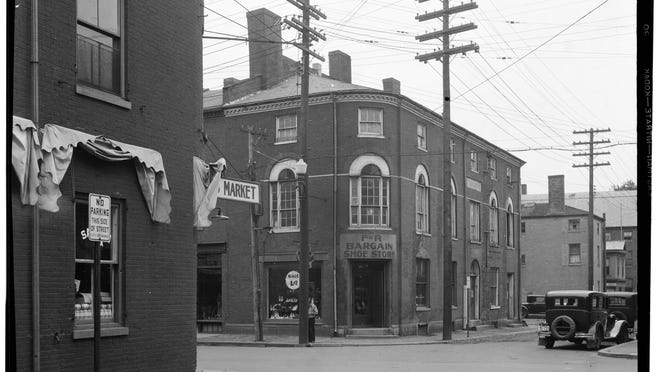 The Old Custom House at the corner of Penhallow and Daniel streets in Portsmouth, NH as seen in 1935. The brick building with the curved entrance served as the city's custom house and post office from 1817 until 1858.