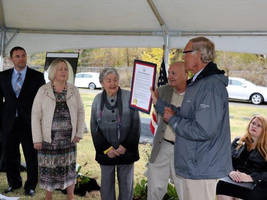 Mayor Jerry Gist presents a proclamation on behalf