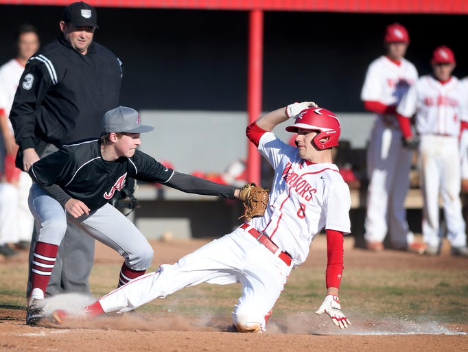 Asheville's Jack Whitehouse tags Erwin's Cameron Howell