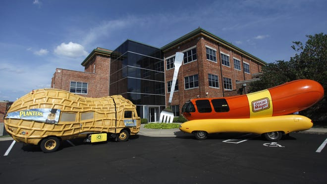 "The Oscar Mayer Wienermobile and the Planters NUTmobile stopped at the world's largest fork in Chesterfield Village for State Senator Bob Dixon to issue a proclamation for ""Stick a Fork in Hunger Day"" on Thursday, August 21, 2014."
