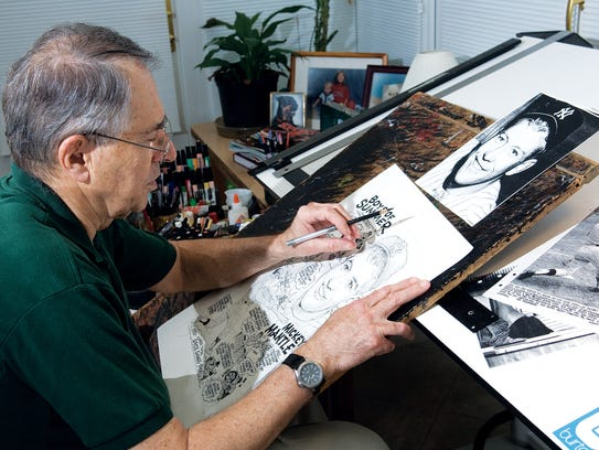 Charlie McGill, sports cartoonist, at his Closter NJ