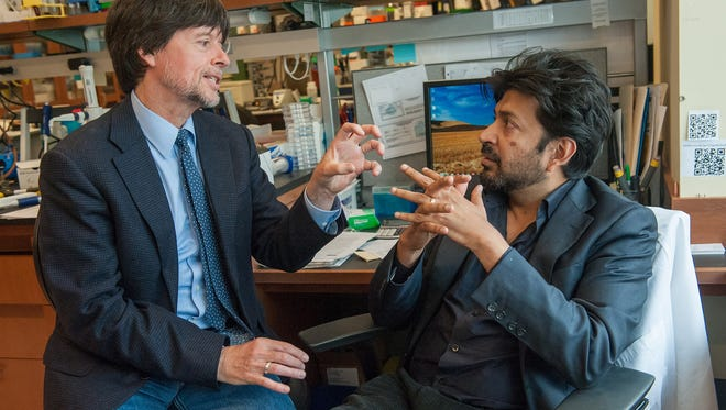 "Ken Burns, left, filmmaker, and Siddhartha Mukherjee, author of ""The Emperor of all Maladies,"" discuss cancer."