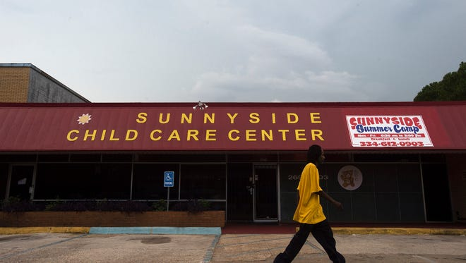 A man walks passed Sunny Side Child Care Center at 3874 S. Court Street in Montgomery.