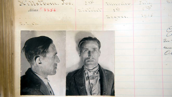 This photo from the Utah state archives shows Joe Hill's prison records, identifying him as Joseph Hillstrom. Lionized in a song sung by Pete Seeger and Bruce Springsteen, labor activist and songwriter Joe Hill is revered by many as a hero and martyr.  To others, Hill was a murderer who gunned down a Salt Lake City grocer and his son and got what he deserved when he was executed by firing squad in 1915.