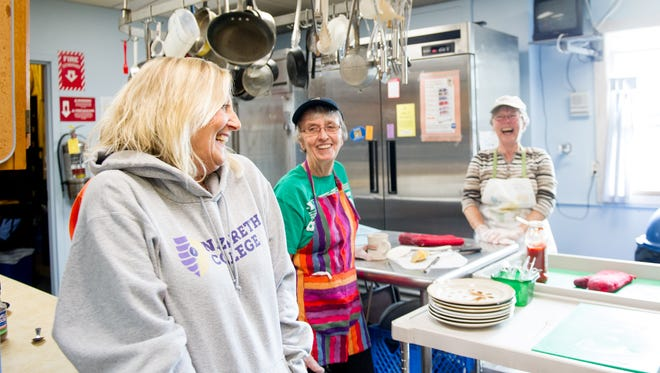 File photo: Fran Morse, who recently retired as executive director of Dimitri House, shares a laugh with kitchen volunteers Ellen Clouser of Pittsford, center, and Kate Alessi of Ontario.