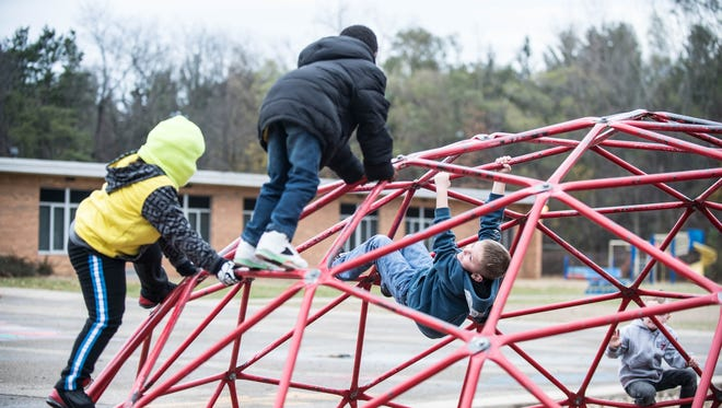 Minges Brook Elementary kindergartners on the playground during recess.
