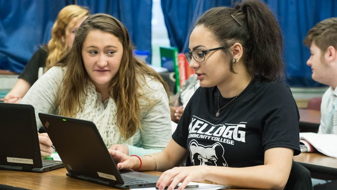 Rachel Suedmeyer, left and Sunny Hayes work during their English class at Calhoun Community High School in Battle Creek.