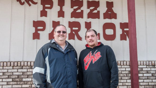 Battle Creek residents Roy Grenier (left) and Marc Wixson have acquired The Pizza Parlor in Bedford Township and plan to re-open the location in two weeks.