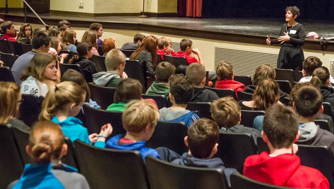 Award-winning story teller Judy Sima tells Marshall Middle School students about her parents who were holocaust survivers.