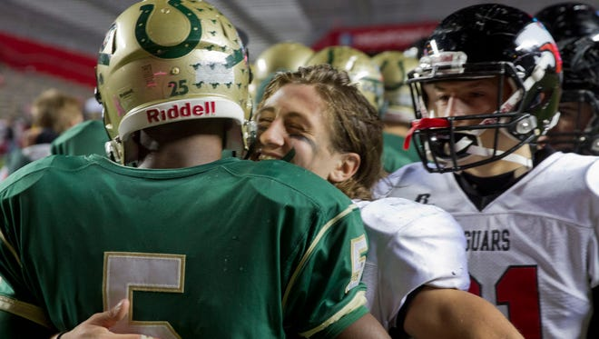 Jackson's Mike Gawlik gets a congratulations hug from Brick Memorial's Brandon Cipriano at the end of game. Jackson Memorial vs Brick Memorial  in 2015 NJSIAA Central Jersey Group Four  Championship Final.
