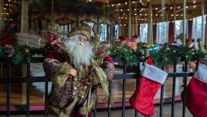 Santa and stockings by the carousel at Binder Park Zoo.