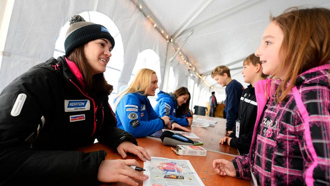 Glen Rock's Summer Britcher, left, signs an autograph for 10-year-old Ella Behm of Elizabethtown, N.Y., during the luge World Cup at the Olympic Sports Complex in Lake Placid Friday in 2014.