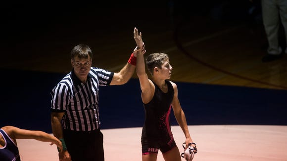 Spring Grove's Clay Baker is announced as the winner against Nathan Townsley in a 106-pound bout in December.