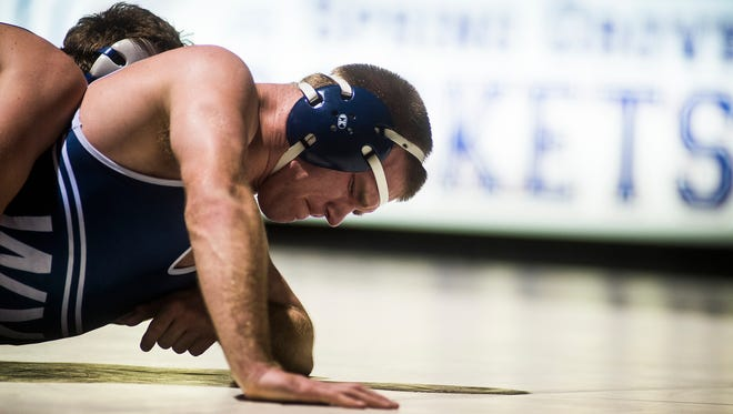 West York's Dan Myers defends off Spring Grove's Jared Barley in the 182 pound weight class Tuesday Dec. 22, 2015 at Spring Grove High School.