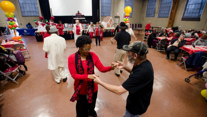 Eright Pitts and Arthurine Smith dance during the Candyland Christmas Ball held by Central Alabama Aging on Wednesday, Dec. 23, 2015.