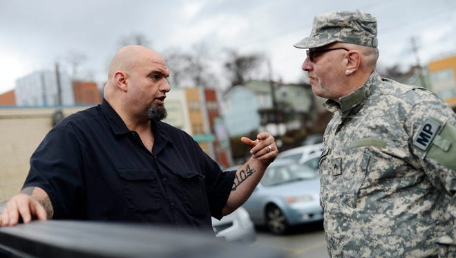 John Regelman, right, talks with John Fetterman, offering to donate live trees to the Free Store in Braddock, Pa. in December. The mayor is a York County native.