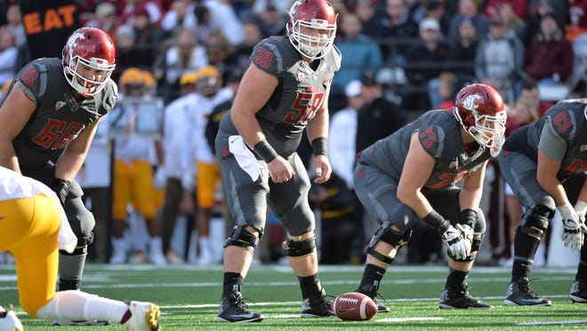 Junior center Riley Sorenson prepares to snap the ball as Washington State takes on the Arizona State Sun Devils during the Cougars' 38-24 win Nov. 7 at Martin Stadium in Pullman, Wash.