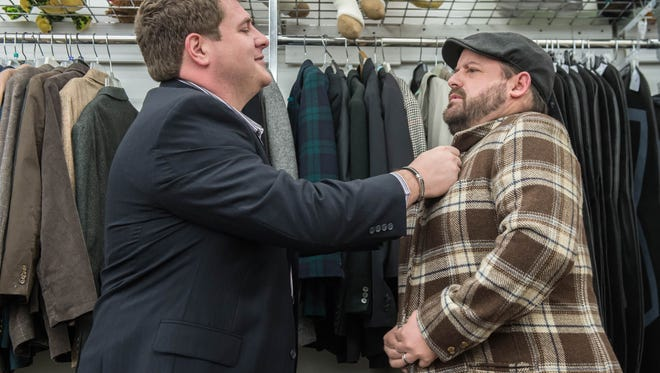 Ken Smith, left, and Jeremy Andrews shop for weird clothes at the Salvation Army in preparation for the Prom for Adults coming up in Battle Creek.