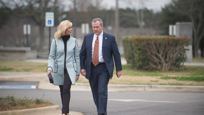 Mike Hubbard and his wife Susan Hubbard walk into the Lee County Justice Center for a hearing on Friday, Jan. 8, 2015, in Opelika, Ala. Hubbard was indicted on 23 felony ethics violations by the Alabama Attorney General's office.
