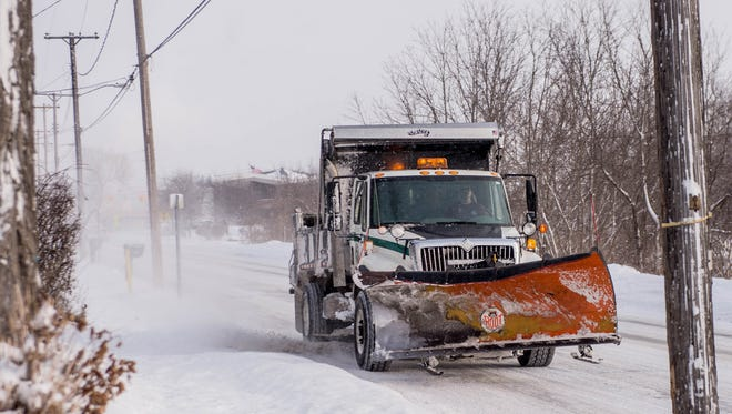 Snow plow truck out along Riverside as as a result of Tuesday's snowfall.