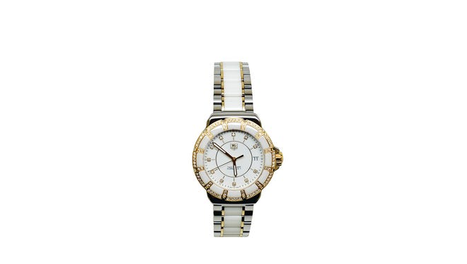Tag Heuer white and gold with diamond bezel, $3,200, Jewelers Trade Shop.