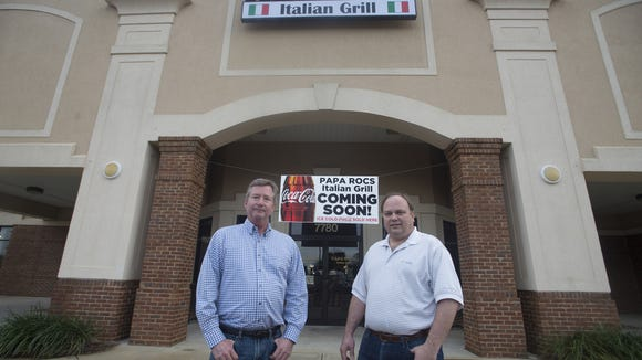 Papa Roc's Italian Grill Proprietors David Lisenby, left, and Joey Avery, right, stand outside the restaurant in Montgomery, Ala., on Wednesday, Feb. 3, 2016.