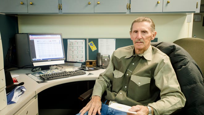 Dallas Mitchell, the longest tenured city employee, sits at his desk on Tuesday, Feb. 9, 2016, in Montgomery, Ala. Mitchell has worked for the city for 47 years.