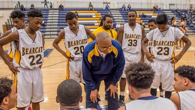 Battle Creek Central JV coach Brian Watkins talks to players during a timeout against Portage Northern on Tuesday.