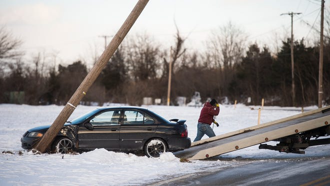 A car is towed after hitting a pole on Brickyard Road near New Oxford on Thursday Feb. 11, 2016 around 4 p.m. Officer Timothy Mulder with Eastern Adams Regional Police said road conditions and driving inexperience were a factor in the crash. The driver was uninjured.