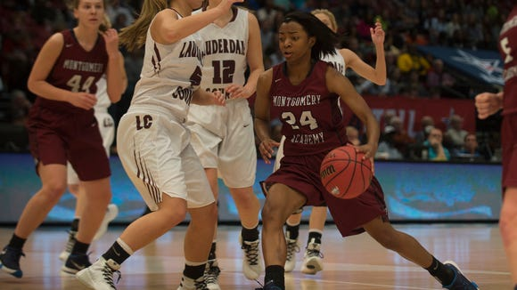 Montgomery Academy's Jade Brooks (24) drives on Lauderdale