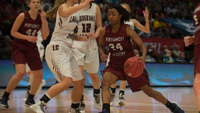 Montgomery Academy's Jade Brooks (24) drives on Lauderdale County's Emma Covington (5) during the AHSAA Class 3A State Championship game on Friday, March 4, 2016 in Birmingham, Ala.