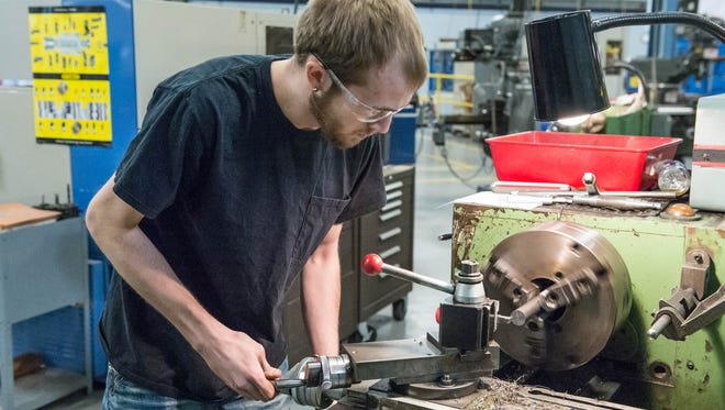 Chris Jarrell, 21, works on an auto cam at the Regional Manufacturing Technology Center.