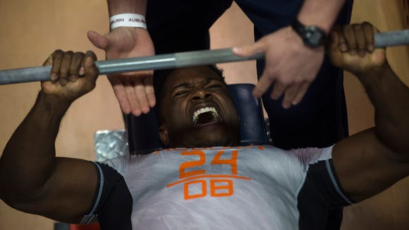 Auburn defensive back Blake Countess performs bench press during Auburn University's Pro Day on Monday, March 7, 2016, in Auburn, Ala.