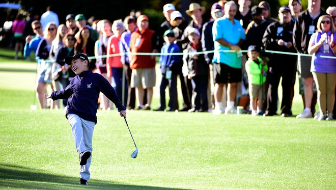 Charlie Danuloff, 9, reacts after  his chip nearly goes in the hole during Sunday's Drive, Chip and Putt national finals at Augusta National.