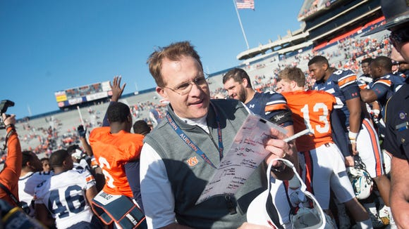Auburn head coach Gus Malzahn leaves the field after