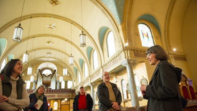 Kathy Urbanic, right, of St. Stanislaus Catholic Church, talked about the history of the church to the Participants of the Celebrate City Living tour, who stopped at the historic landmark on Saturday, April 9th.